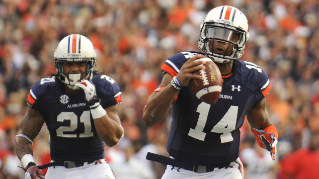 Auburns Nick Marshall Keeps It As Tre Mason Trails The Play Kyle Taylor Photo